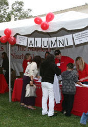 Alumni volunteers at table