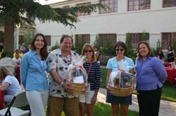 Photo of happy parents with gift baskets