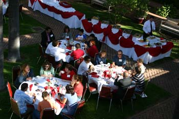 view from above of three tables of alumni in the south quad court yard