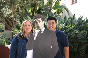 Two CSUCI alumni with a cardboard cutout