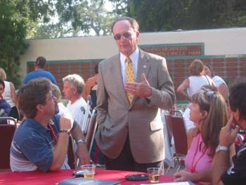 President Rush talking to some alumni