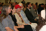 Audience members look on attentively