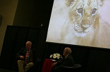 Rich Block shows photograph of lion cub.