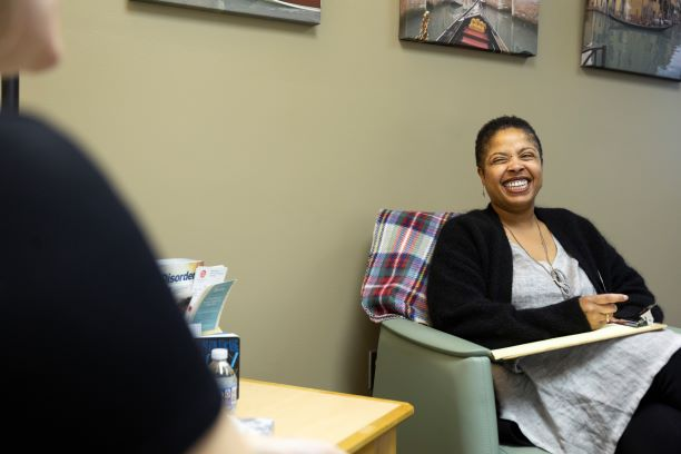 African American woman clinician laughing with student