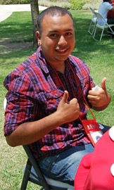 "Photo of an EOP student giving a ""thumbs up."""