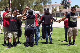 Photo of EOP students participating in the Human Knot activity.