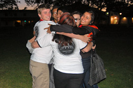 Photo of EOP students in a group hug.