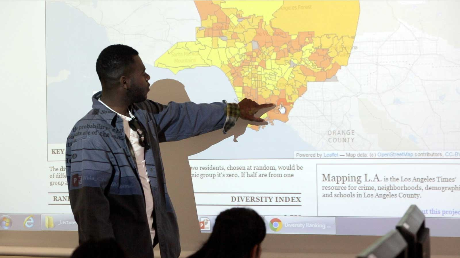 Sociology student, Justin Bailey, points to areas in LA that have high ethnic diversity