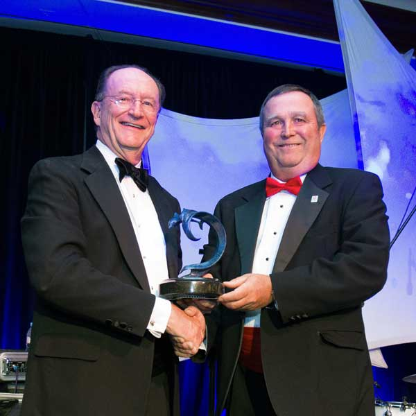 President Richard Rush presents the Robert J. Lagomarsino Award to recipient Steve Blois.