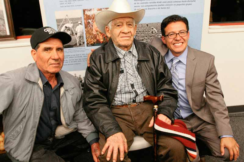 Professor Alamillo sitting with Former Ventura County Farm Workers
