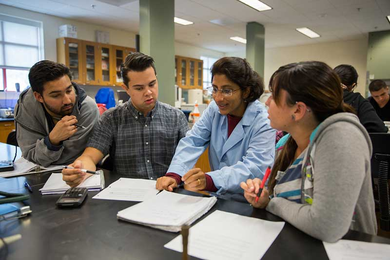 Dr. Parmar working with students during a lab.