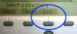 Exit button, 2nd from right directly under display
