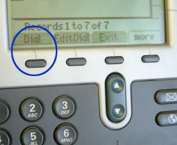 Dial button, first from the left and below the display screen