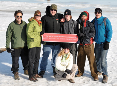 Students and Advisors from BIO/POLS 345 stand on frozen Arctic Ocean