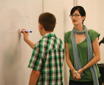 Professor Kathryn Leonard instructing a student