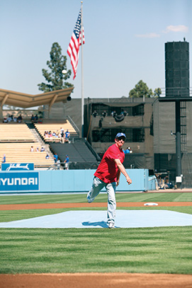 President Rush throwing the ceremonial first pitch at Dodger Stadium