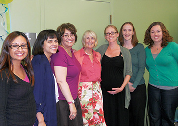 Jane Sweetland (pink shirt) and staff