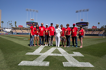 President Rush and Captain Larry Vasquez pose with members of the CI community, Union Bank, and Pacific Western Bank for a picture at Dodger Stadium in celebration of the 10th Annual Alumni & Friends Dodger Day.