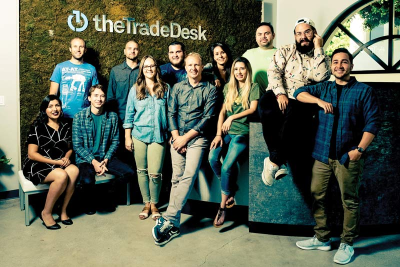 Trade Desk founder and CEO, Jeff Green, shown with other members of his team, including CSUCI as well as other CSU alums. Front row (from left to right): Valerie Valdez, Taylor Tally, Katherine Armstrong, Jeff Green, Miranda Jordan, Lenin Jaime, Jimmy Bañales; Back row (from left to right): David Zych, Ryan Anderson, Thomas Hamlin, Melanie (Milam) Polishchuk, Henry Valdez
