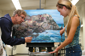 Professor Reilly instructs student artist