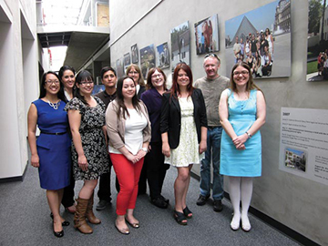 The library's photo exhibit team: Front row, left to right: Elnora Kelly Tayag, Kaela Casey, Alysha Cordova, Sarah Martinson, Laura Worden; Back row, left to right: Martha Reyes, Marco Ruiz, Barbara Cullin, Evelyn Taylor, Ben Hipple
