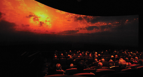 "Audience members watch ""Beyond All Boundaries"" at the National WWII Museum"