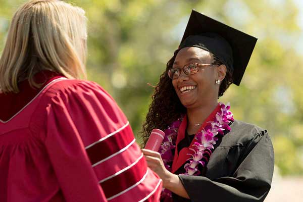 President Beck sees many student smiles at Commencement.