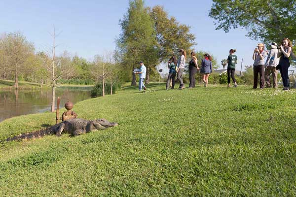 "Students observe ""Boots"" a seven-foot long alligator"