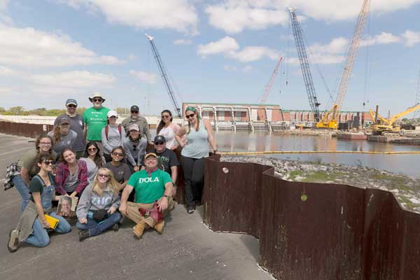 Attendees of the New Orleans Service-Learning Trip pose near the London Avenue Canal Temporary Flood Gates/Pump Station
