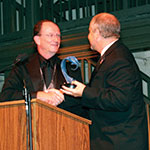 mark lisagor accepting an award from president rush