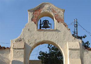 Older style church bell sits atop the steeple