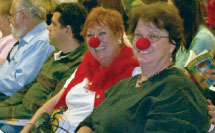 patch adams fans showing their clown side with red noses