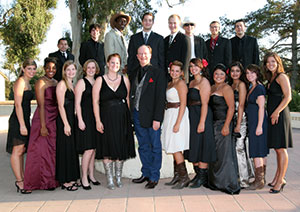 president rush and students gather together at annual dinner party