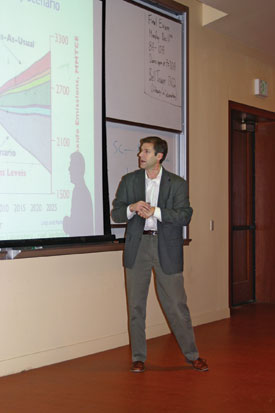 Professor speaking at symposium on environmental issues