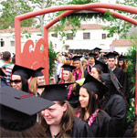 More than 450 students process through arch at Commencement