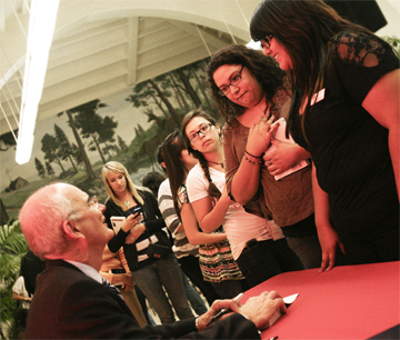 Author Gregory H. Williams greets visitors and signs copies of his book