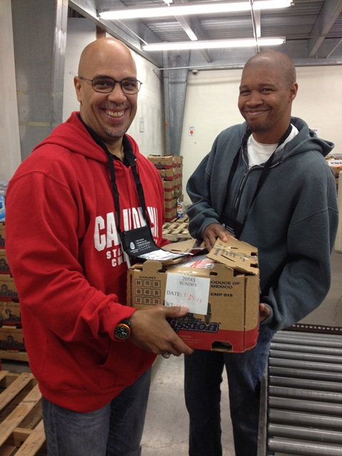 Dr. Sawyer and Janson Chapman volunteer at Food Share