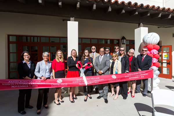 Flanked by Other Dignitaries, President Beck and Student Government President Michelle Noyes Prepare to Cut the Ribbon at the Santa Rosa Village Ribbon Cutting Ceremony