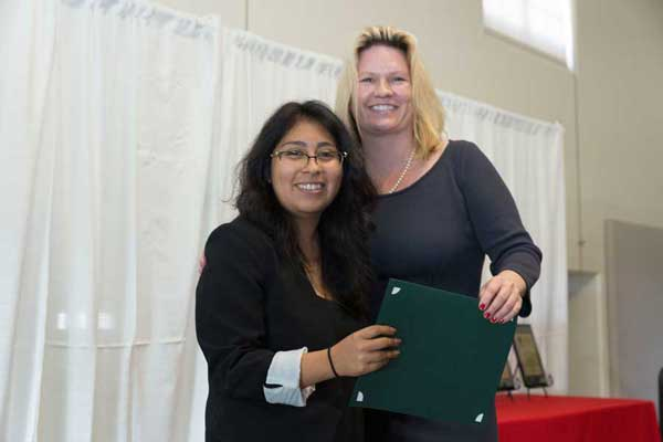 President Beck poses for a quick pic at CI's 2017 Celebration of Service with Marisol Luis, one of the students honored during the program; Marisol received a Campus Compact certificate for being named a 2017 Newman Civic Fellow