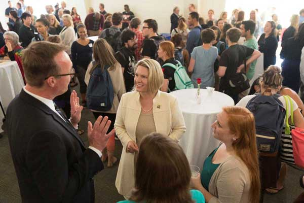 Dr. Erika Beck is greeted at the All Campus Welcome Reception on April 4, 2016.