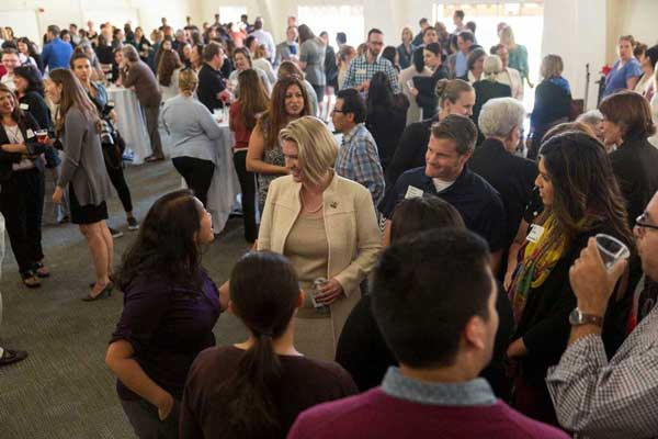 Grand Salon, packed with conversations, during the All Campus Welcome Reception in honor of Dr. Erika Beck.