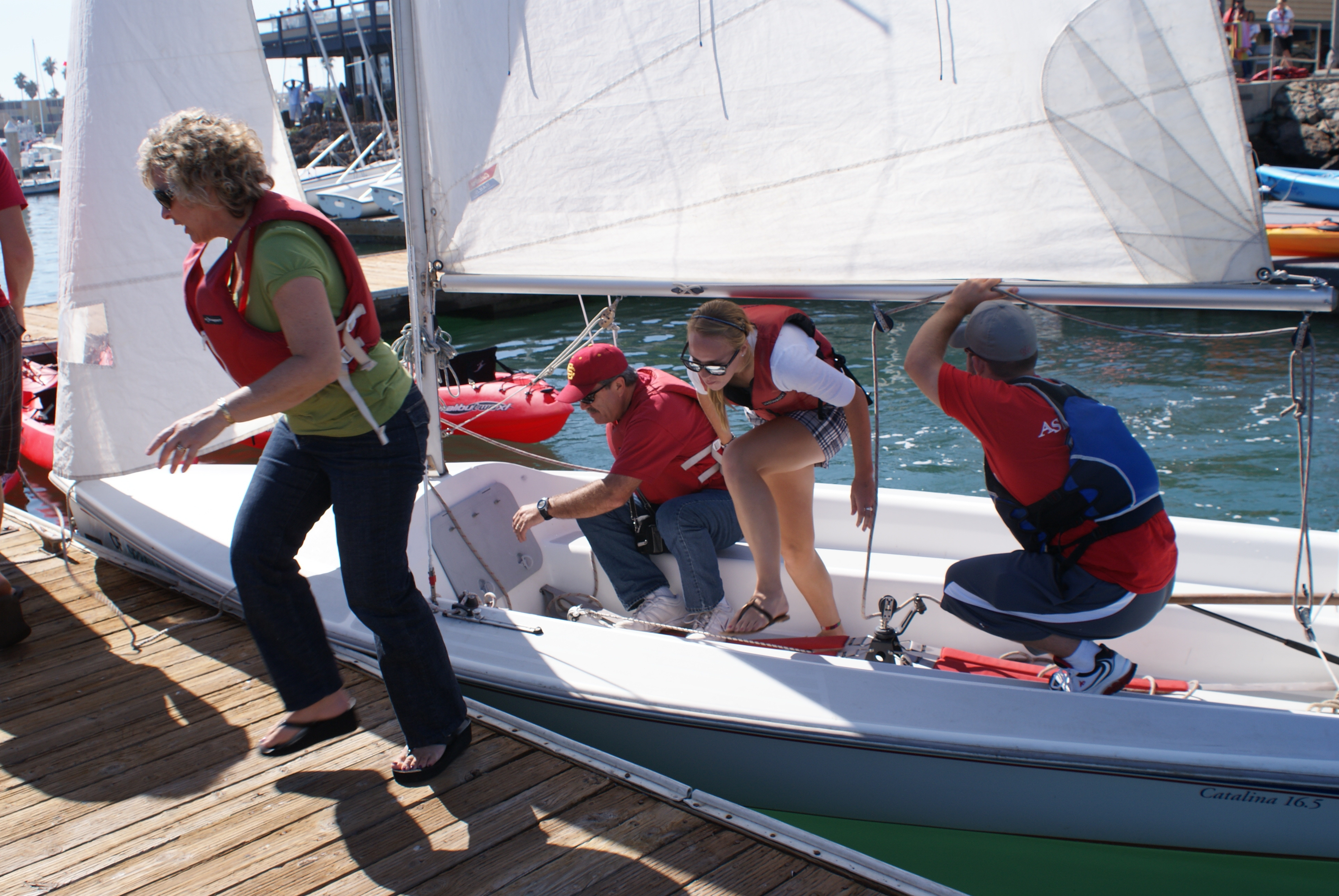 Students getting out of a sailboat
