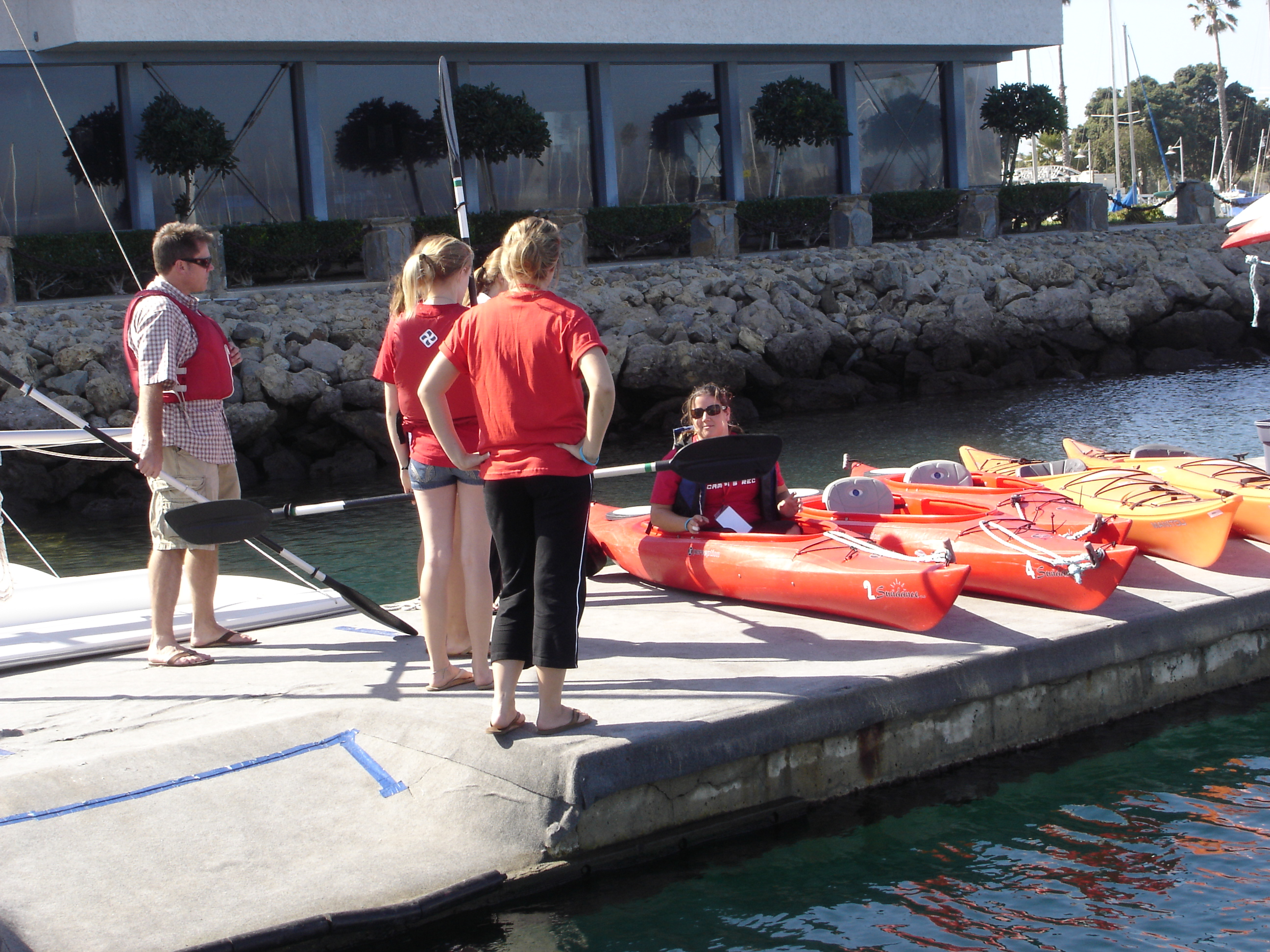 Students getting in to kayaks