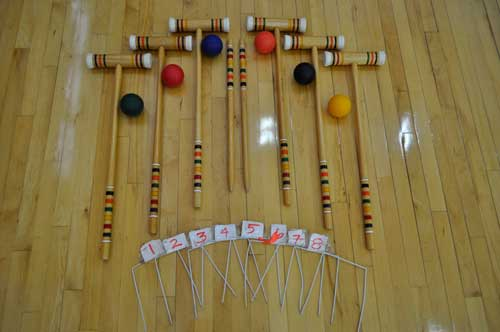 Croquet set with mallets, wickets, and balls