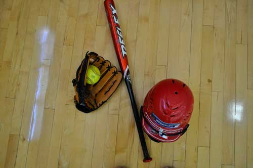 Softball bat, glove, and helmet