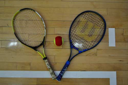 Two racquets and tennis ball