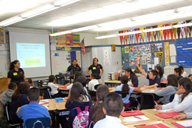 Photo of CI reps visiting a local classroom.