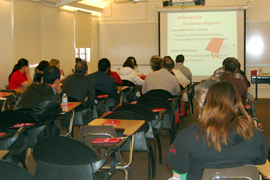 Photo of parents attending a PIQE presentation.