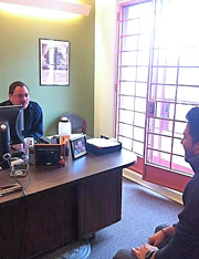 Photo of Jay Derrico, Veterans Affairs Program Coordinator, meeting with a student veteran.